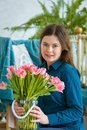 stock image of  Spring portrait of a girl with pink tulips