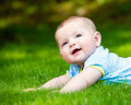 Spring portrait of happy baby boy outdoors Royalty Free Stock Photo