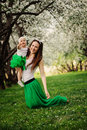 Spring portrait of mother and baby daughter playing outdoor in matching outfit - long skirts and shirts Royalty Free Stock Photo