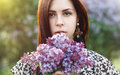 Spring portrait of a pretty woman holding a lilac flowers. Outdo Royalty Free Stock Photo