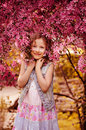 Spring portrait of smiling child girl in pink cherry blossom Royalty Free Stock Photo