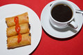 Spring rolls three with chili sauce and a coffe cup Stock Photography