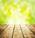 Spring rustic template background with wooden table and text space old vintage planked wood in perspective on fresh bright green Royalty Free Stock Photos