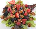 Spring salad with berries and peanuts close up Stock Images