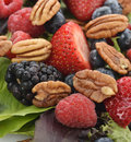 Spring salad with berries and peanuts close up Royalty Free Stock Images