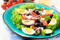 Spring salad fresh with vegetables and cheese selective focus on the front part of Royalty Free Stock Photos