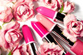 Spring set of lipsticks in pink flowers. Beauty cosmetic collection. Fashion trends in cosmetics, bright lips Royalty Free Stock Photo