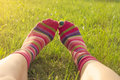 Spring teenage girl enjoying feet in the grass Stock Photography