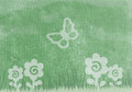 Spring texture green fabric with floral motifs and butterfly Royalty Free Stock Images