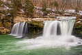 Spring thaw at the upper cataract whitewater plunges over falls a waterfall in indiana as snow and ice melts after a very cold Royalty Free Stock Photography