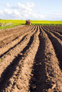 Spring tillage in the ground and  tractor Stock Photos