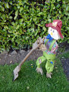 Spring time tidy scarecrow doing the garden Royalty Free Stock Photo