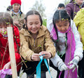 Spring tree planting ulan ude russia may unidentified children tie up ribbons on young trees they have just planted near the city Royalty Free Stock Photo