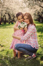 Spring vertical portrait of happy mother and kid daughter