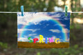 Spring washday beautiful landscape with rainbow and colorful letters in the grass spelling out drying Royalty Free Stock Photos