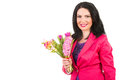Spring woman holding flowers happy fresh isolated on white background copy space for text message in left part of image Royalty Free Stock Images