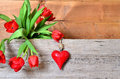 Spring wood background old and red tulips and heart Stock Images