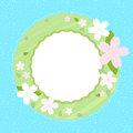 Spring wreath with cherry blossom on light blue background with