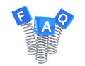 Springs with faq cubes on a white background Royalty Free Stock Photo