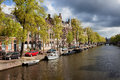 Springtime in amsterdam by the kloveniersburgwal canal the city of netherlands north holland province Stock Image