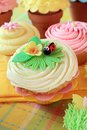 Springtime cupcakes with flowers and a ladybug Royalty Free Stock Photography