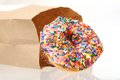 Sprinkle donut paper bag Royalty Free Stock Photos