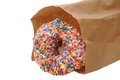 Sprinkle donut in paper bag isolated on white Stock Photos