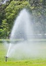 Sprinkle high pressure water working in public park Royalty Free Stock Photos