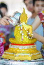 Sprinkle water onto a buddha image thai culture in songkran festival Royalty Free Stock Photography