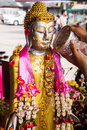 Sprinkle water onto a buddha the songkran festival songkran has traditionally been celebrated as the new year Royalty Free Stock Image