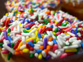 Sprinkled donut. Close up Royalty Free Stock Photography