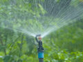 Sprinkler for agricultural watering system. Royalty Free Stock Photo
