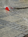 Sprinkler on street a water a spraying water Royalty Free Stock Photo