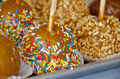 Sprinkles on caramel apple Royalty Free Stock Photo