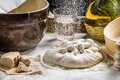 Sprinkling flour pizza dough closeup of Stock Image