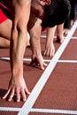 Sprinter man leaps from starting block Stock Photo
