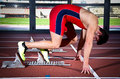 Sprinter man leaps from starting block Royalty Free Stock Photos