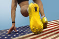 Sprinter start us flag with spikes is in position on grungy Stock Photography