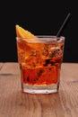 Spritz aperitif - orange cocktail with ice cubes