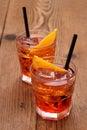 Spritz aperitif, two orange cocktail and ice cubes