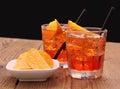 Spritz aperitif - two orange cocktail with ice cubes