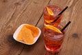 Spritz aperitif - two orange cocktail, ice cubes, potato chips