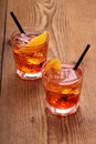 Spritz aperitif, two orange cocktail with ice cubes