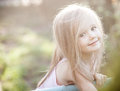 Sprout plant growing from little girl hands Royalty Free Stock Photo