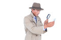 Spy looking through magnifier on white background Stock Photography