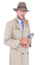 Spy looking through magnifier on white background Royalty Free Stock Photography