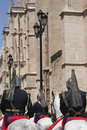 Squadron mounted on horseback of trumpets and kettledrums the brotherhood la paz passing by the cathedral sevilla Royalty Free Stock Photo
