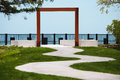 Square arc over the path to the lakefront red metal Stock Images