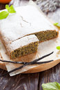 Square cake poppy seeds orange zest closeup Stock Photos