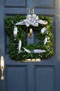 Square christmas wreath on door Stock Photo